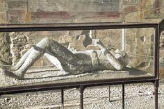 A plaster cast of a victim of Mount Vesuvius' eruption displayed in Pompeii.