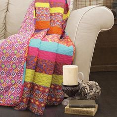 Add boho-chic style to your living room or master suite with this reversible cotton throw, featuring a geometric motif on one side and a patchwork striped mo...