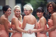 4 bridesmaids + bride in the middle looking back with arms and hands wrapped around each other. Captures a great shot from a different perspective.