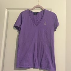 Light purple Polo v-neck with white horse This shirt has been worn maybe 4 times, it's in great condition. Very little sign of being worn. Fits a little small due to fabric. I normally wear a small, but I got a medium to be safe. It's somewhat fitted. Horse is white. Polo by Ralph Lauren Tops Tees - Short Sleeve