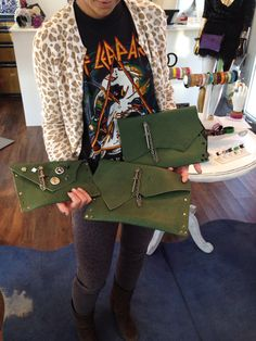 Music and fashion. Leather Couture by Jessica Galindo army green Dagger Clutches.