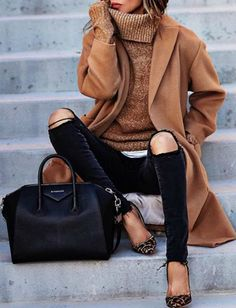 Sasha Simon + gorgeous overcoat style camel coat + distressed black skinny jeans + knitted polo neck sweater + pair of statement heels + inject some colour into the outfit. Brands not specified.