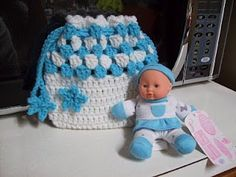 """Free Baby, You're a Star Cradle Purse Crochet Pattern -- uses This purse is designed for a 6"""" doll. The one in the picture was purchased at WalMart in the doll/toy section."""