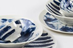 Indigo Storm is Faye Toogood's reinterpretation of traditional creamware. Fine earthenware offset with a rich, deep blue pattern. Fine earthenware – glazed Made in Stoke on Trent, England ø x h Kitchenware, Tableware, Calm Before The Storm, Dining Furniture, Dinner Plates, Serving Bowls, Barware, Indigo, Faye Toogood