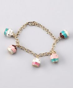 """Cute jewelry for little girls"" is the original quote. Haha, I want a cupcake bracelet...and I'm not a little girl."