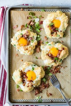 Cloud Eggs with bacon and grated Gruyere cheese.