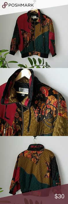 1980s Giacca Sport Unisex Zip Up Jacket Vintage 80s Giacca Sport Jacket surely to make a statement! Color blocked with colors, quilted textures and patterns.  Features high neck with drawstring, front zipper, 2 exterior pockets with zipper and fitted elastic ban trim cuffs and bottom of jacket. Color story of golds, reds and greens with traces of black, orange and browns. Black interior lining size M. Material breakdown in photo. Some loose threads as seen on cuff  however no notable flaws…