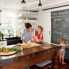 Kitchen chalk board...and butcher block...very nice!