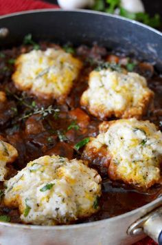 Guinness Beef Stew with Cheddar Herb Biscuits; cook biscuits separately and spoon stew over