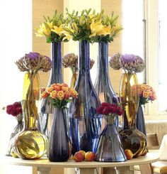 assortment of flowers in blue glass vases .Ken Marten.