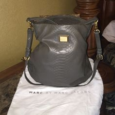 Marc by Marc Jacobs previously loved handbag Marc by Marc Jacobs pre-owned dark green snake print handbag. Handbag comes with original dust bag and is in great condition. Only wear is shown on the inside of the handle. Marc by Marc Jacobs Bags