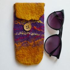 Soft, protective, wet felted, seamless, in shades of yellow orange and purple…