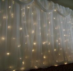 Lights behind curtains. I did something similar for my reception- so simple and easy but so beautiful in a classy elegant way.