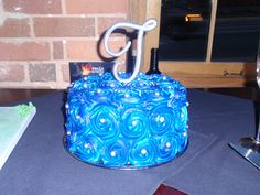 Now that beautiful white Rosette cake is a Stunning Navy blue with silver balls!!!