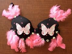 This bra was made by the Butterfly Effect team. It is a 38 D and missing a few feathers from the front of the bra.