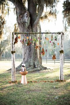 12 Fall Wedding Arches That Will Make You Say 'I Do!': #10. Boho fall arch with hanging flowers and leaves