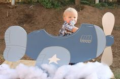 An airplane theme party is certainly deserving of a fun photo op corner. Imagine all your little pilots lining up to board this cute little plane. Too cute!