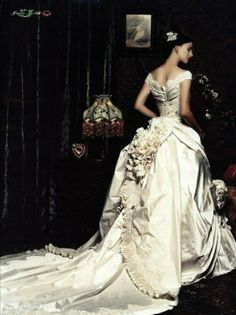 I like the portrait-type neckline, that low sweep across the shoulders with some fullness to it (so it doesn't lay flat) Baroque wedding dress via wedbook