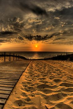 Beautiful Nature.....sunset....on the sand....and on the water reflections of…