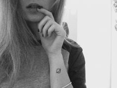 Saturn tattoo on Georgia Sayers left wrist: The...