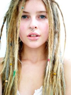 A lovely blonde dread-head with snake bites and then some (: I like her hair beads, too