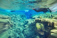 Snorkeling in Silfra fissure, Thingvellir National Park, Iceland. Photo by Francisco Antunes