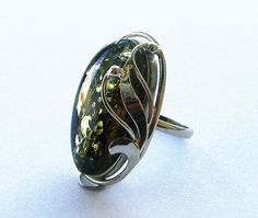 Hey, I found this really awesome Etsy listing at https://www.etsy.com/listing/223637095/genuine-baltic-green-amber-ring