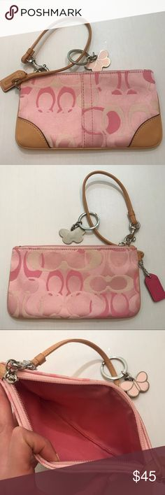 Coach Wristlet with Coach Butterfly Keychain Coach Wristlet with Coach Butterfly Keychain. Wristlet exterior is pink, light pink, and cream colored with leather trim and strap. Interior is pink. Zipper and Coach tag are also pink. Butterfly keychain is light pink and may need to be shined, but it is not scrapped or dented. Both are in good condition. Coach Bags Clutches & Wristlets