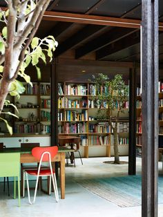 Raven Street House by James Russell Architects. This looks like a library in a shipping container house to me.