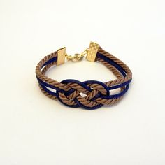 Brown and navy blue knotted nautical rope bracelet with gold anchor charm