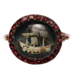 Ring of gold and ivory with garnet surround, 1790s.