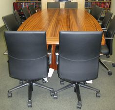 Here is a solid sapele wood conference room table with a weng'e border inlay.