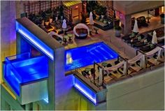 The world-renowned pool at Joule Hotel offers stunning views of Dallas' iconic skyline.