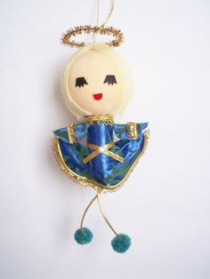Darling vintage angel ornament made in Japan, with sticker! She is so super cute with her yellow yarn hair and royal blue and gold dress! Love