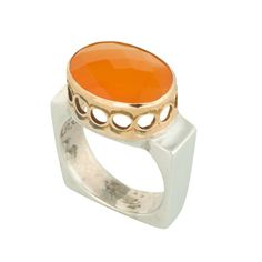 Coronation Day (CD010) A true feminine silhouette, this sterling silver ring features a square shank set with a cornelian stone and a 9k gold crown.