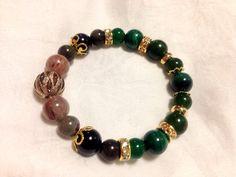 Loki Bracelet.  Malachite, dart green jade, green onix, golden sheen obsidian, Picaso jasper and multi-inclusion quartz.