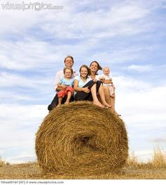 Family Photos with hay bales - Maybe parents in front on the ground with a pet and the kids on the bale!