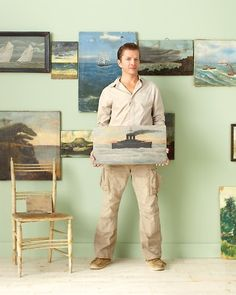 John Derian with his collection of paintings.