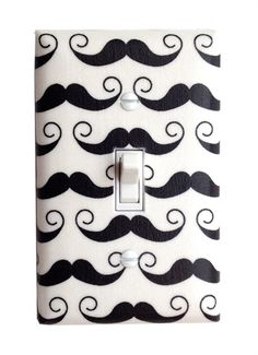 I mustache my kids to turn off the lights when they leave a room.  ;-)  From Rosenberry Rooms.