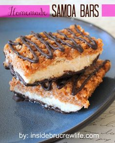 Homemade Samoa Bars ~ Shortbread cookies topped with a caramel coconut layer and dipped in chocolate.