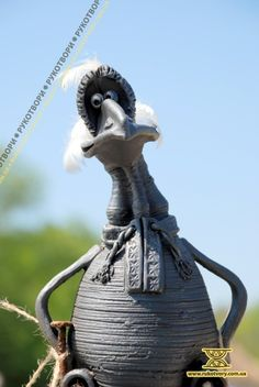 A whimsical work by contemporary Ukrainian pottery artist Viktor Androshchuk.