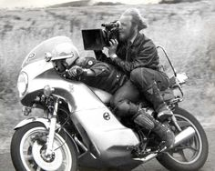 Cinematographer Dave Eggby shooting footage for the first Mad Max movie. At least the boots are safety-first, right?