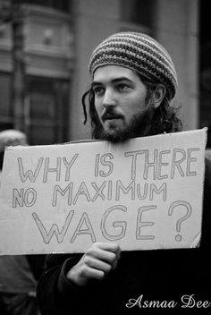 """Why is there no maximum wage?"" At Occupy Toronto, October 22, 2011.  Photo credit: Asmaa Dee Photography"