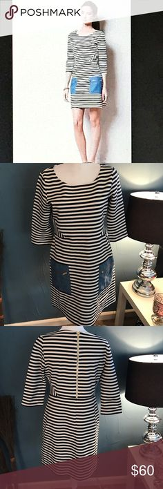 NWOT LE Anthropologie Tabitha Marin dress New without tags. Cream and navy blue stripe. Two front done and pockets with gold zippers. Gold zipper on the back. Material description in pictures. 36 inch bust 34 inch waist 33 inch length. Dress does stretch if needed. First picture is a stock photo Anthropologie Dresses Midi