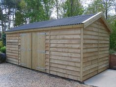 timber workshop with featheredge boarding and onduline roofing Outdoor Storage Sheds, Outdoor Sheds, Outdoor Gardens, Workshop Shed, Workshop Design, Wooden Workshops, Timber Garage, Shed Design, Cabin Design