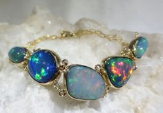 A Spectacular Opal Bracelet!  100% Natural Ethiopian Opal & 14k Gold.  Visit our Etsy Store for more One of a Kind Handmade Opal Jewerly
