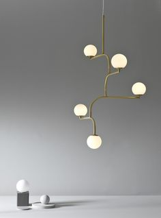 Mobil is build up by four equal parts linked to each other. Together they create a pendant lamp with graphic qualities and movement that looks interesting from all angles. Lighting Inspiration, Hanging Light Fixtures, Lamp Design, Home Lighting, Lounge Lighting, Lighting Trends, Scandinavian Lighting, Ceiling Lights, Lights