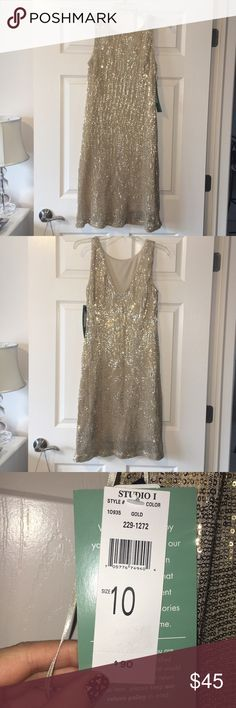 NEW WITH TAGS NEVER WORN.  Gold sequin dress. Beautiful gold sequin dress, never worn. New with tags still on. Dresses