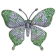 Demantoid Garnet Tsavorite Diamond Butterfly Pin Brooch   From a unique collection of vintage brooches at http://www.1stdibs.com/jewelry/brooches/brooches/