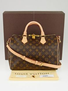 7dbd3c45954b Louis Vuitton Monogram Canvas Speedy 30 Bandouliere Cross Body Bag. Get the  trendiest Cross Body